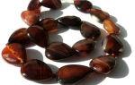 Сардоникс: история происхождения и описание камня, его основные свойства, как отличить от подделки, фото галерея